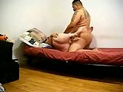 Brunette BBW strips and gets her clam munched before her man pounds it into kingdom come