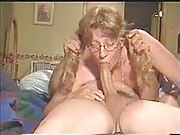 Pigtailed blonde in glasses gives her man a hell of a pov blowjob in this nasty video
