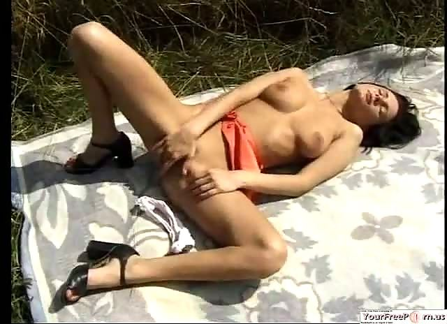 Amateur girl fucking dildo in nature