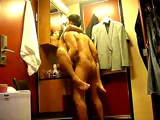 Brunette couple fucking hard in cloakroom