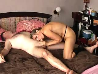 Slut sucking cock on bed