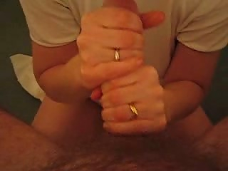 Amateur girl doing handjob using lube