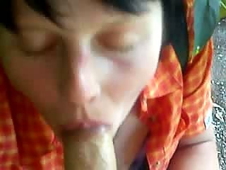 Brunette mature sucking cock under bridge