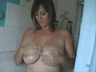 Milf washing jugs in the shower