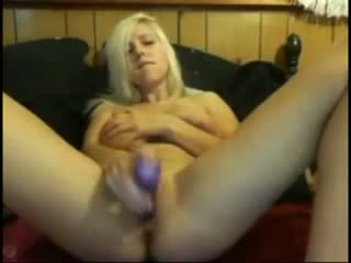 Blonde with big boobs plays with dildo in webcam