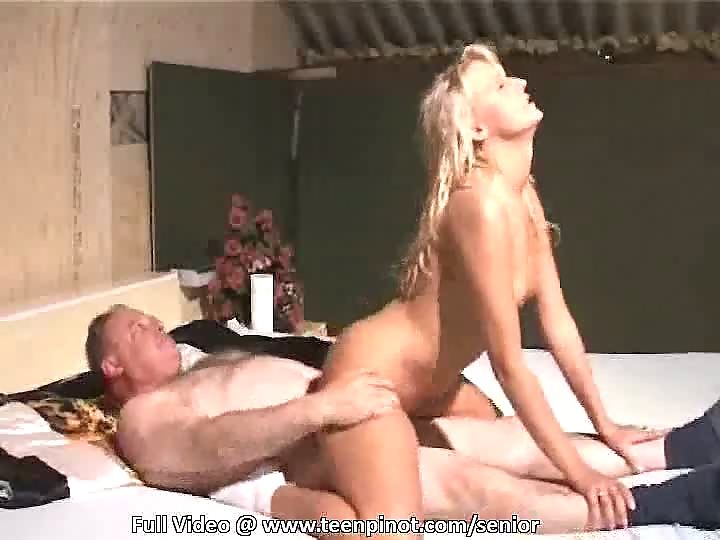 Blonde girl riding old man in front of camera