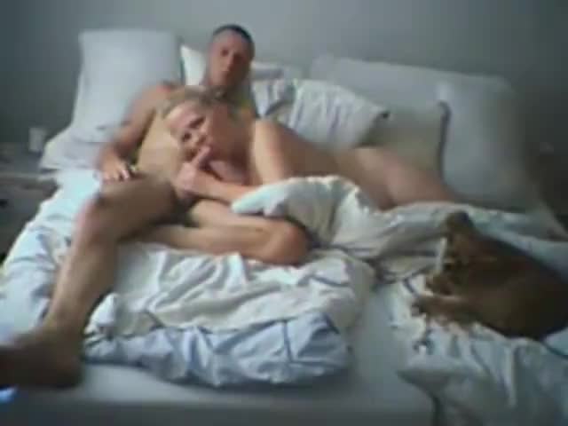 Married couple having sex on bed