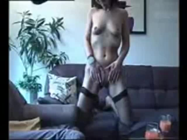 Amateur girl having sex with man on couch