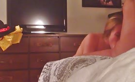 Guy Sits on Bed and Gets a Blowjob