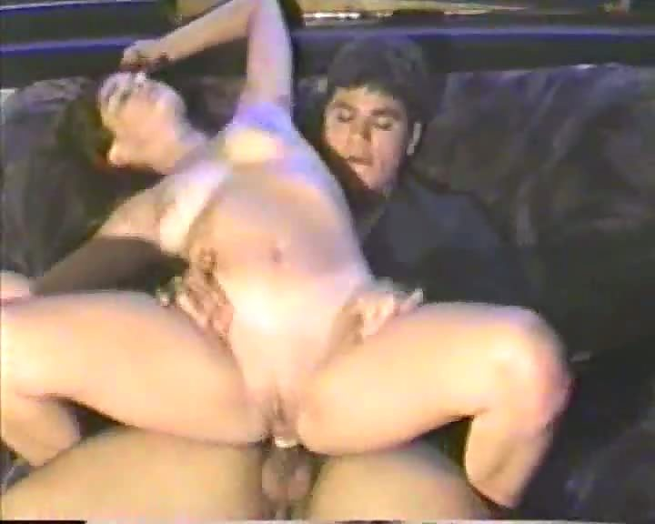 Brunette riding cock on couch