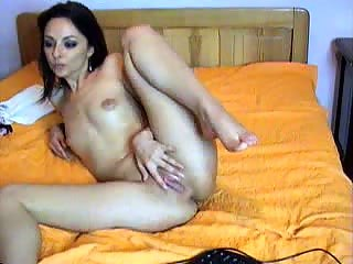 Sexy brunette chcik masturbating in front of webcam