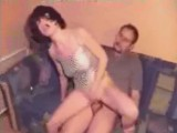 Brunette girl riding her boyfriends cock on couch