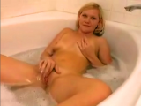 Blonde horny girl gets horny when having bath, so she starts fingering her pussy in water.