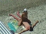 Horny couple fuck at the public beach