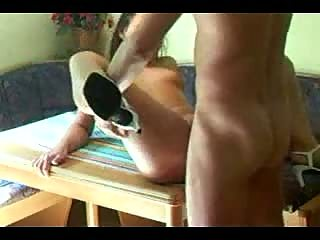 Brunette woman gets fucked on table
