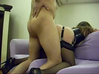 Latex chick fucked on couch