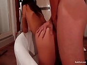 Brunette gets her anal hole penetrated and pounded hard doggy style