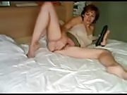 Brunette Teen Fucking Dildos on Bed
