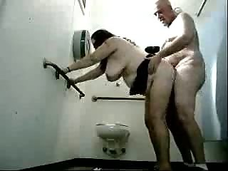 Fat woman and her man fucking on public toilet