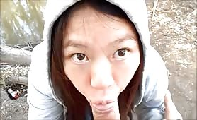 Asian Hides Behind a Hoodie While Giving Head Outdoors